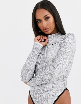 Nike white snake print long sleeve bodysuit
