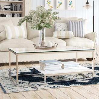 Wade Logan Saniya Frame Coffee Table with Storage Color: White