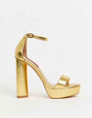 London Rebel extreme platform heeled sandals in gold