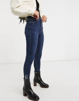 Topshop Jamie skinny jeans with rip hem in indigo wash-Blue
