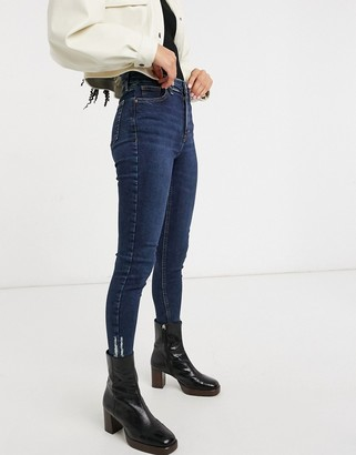 Topshop Jamie skinny jeans with rip hem in indigo wash