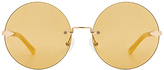 Karen Walker Disco Circus in Metallic Gold.