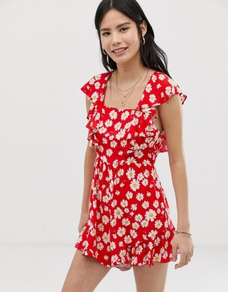 Kiss The Sky backless playsuit in daisy print-Red
