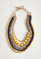 "ASN 1907 Wondering if you can sport this statement necklace with that look? The answer is always, ""Yes!"" Layer this accessory over any ensemble to flaunt its layered strands of navy and taupe beads, golden chains, and goldenrod stones - eliciting ooh s"