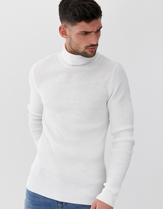 ASOS DESIGN muscle fit ribbed roll neck sweater in white