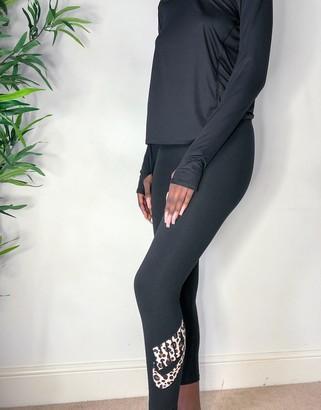 Nike leggings with leopard print swoosh in black