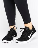 Nike Running Free Run Flyknit Sneaker In Black