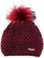Norton Co. racoon fur pom pom hat