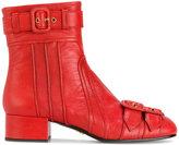 Prada buckle embellished boots