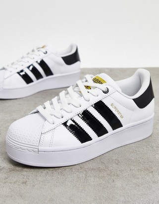 adidas Superstar Bold platform trainers in white and black