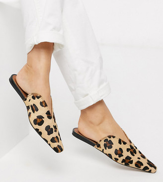 Asos DESIGN Wide Fit Landing leather mules in leopard