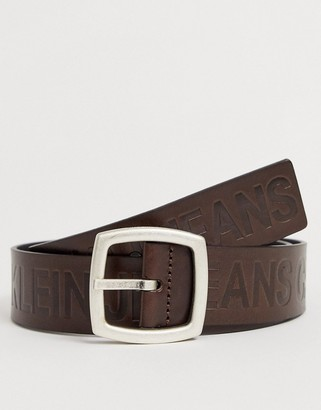 Calvin Klein Jeans Magnified embossed logo leather belt in brown