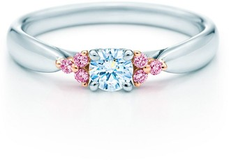 Tiffany & Co. HarmonyTM Fancy Pink diamond side stone ring in rose gold and platinum