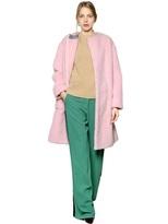 uncategorized  Who made Rihannas blue jeans, pink coat, brown print handbag, tan boots, and gray tee?