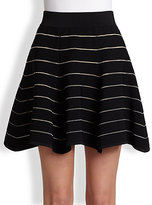 beyonce knowles  Who made  Beyonce Knowles black stripe cropped top and white flare skirt?