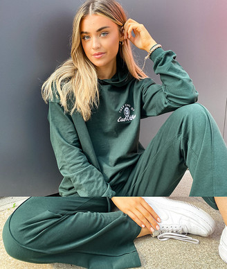 ASOS DESIGN tracksuit oversized hoodie / straight leg sweatpants with take care embroidery in dark green