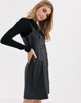 New Look leather look button through pinny in black