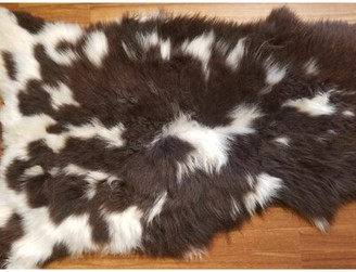 Union Rustic Bustamante Spotted Sheepskin/Wool Black Area Rug Union Rustic