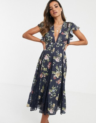 ASOS DESIGN midi dress with godet lace inserts in navy based floral