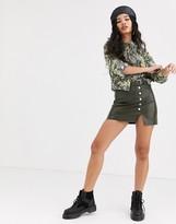 Bershka faux leather mini skirt with button detail in khaki
