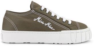 Miu Miu Low Top Sneakers in Military & White | FWRD
