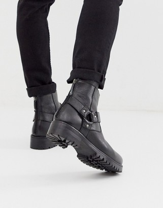 ASOS DESIGN chelsea boots in black tumbled leather with chunky sole and strapping detail