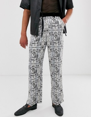 ASOS EDITION wide leg suit trousers with all over monochrome print and velvet detail