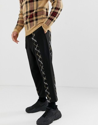 ASOS DESIGN drop crotch smart pants in black with checked front stripe