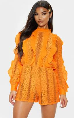 PrettyLittleThing Bright Orange Lace Frill Detail Long Sleeve Playsuit