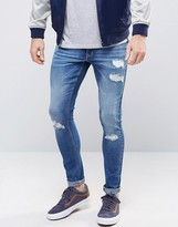 Asos Extreme Super Skinny Jeans With Rips In Mid Wash
