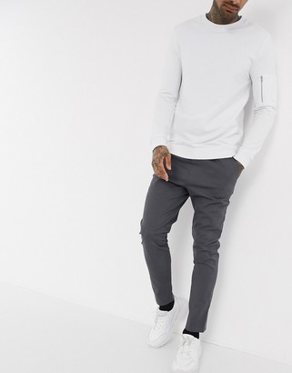 Asos DESIGN skinny chinos with elastic waist in washed black