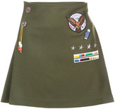 Mira Mikati appliquéd badge pleated skirt