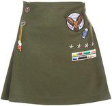 Mira Mikati appliquéd badge pleated skirt