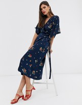 Liquorish wrap front midi dress with tie belt and flutter sleeves in navy floral