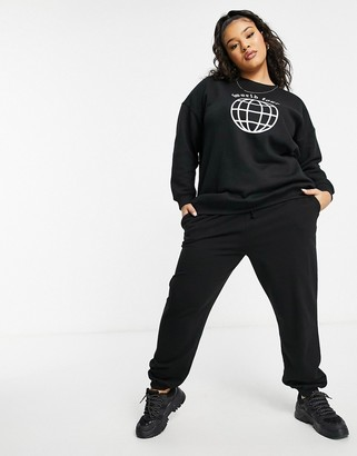 Lasula Plus oversized motif sweatshirt in black