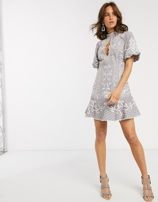 ASOS DESIGN embroidered mini dress with keyhole and pep hem