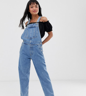 ASOS DESIGN Petite denim dungaree in midwash