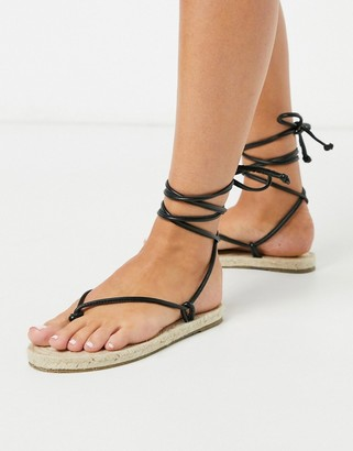 ASOS DESIGN Joe minimal tie leg espadrille flat sandals in black