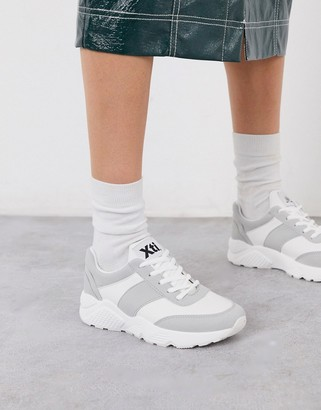 Xti lace up runner sneakers in beige