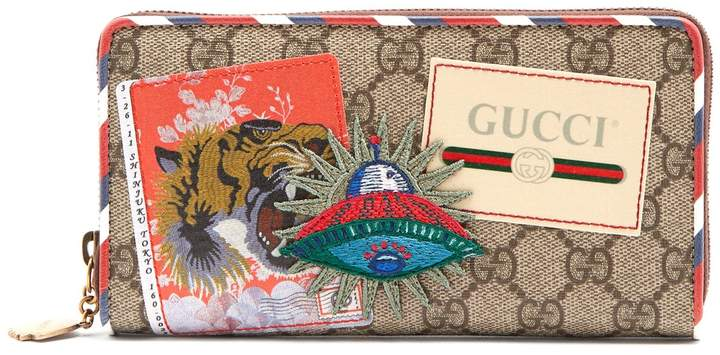 Gucci GG Supreme logo and spaceship-patch wallet