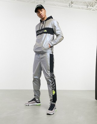 Ellesse x Smiley Ranieri reflective trackpants in grey
