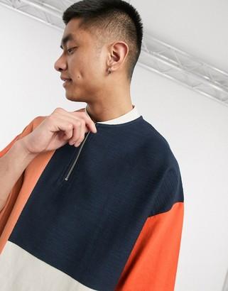 ASOS DESIGN oversized t-shirt with baseball zip neck and colour block