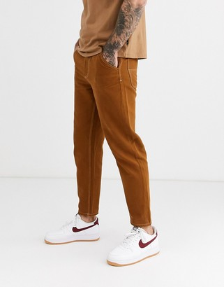Celio worker trousers in tobacco-Brown