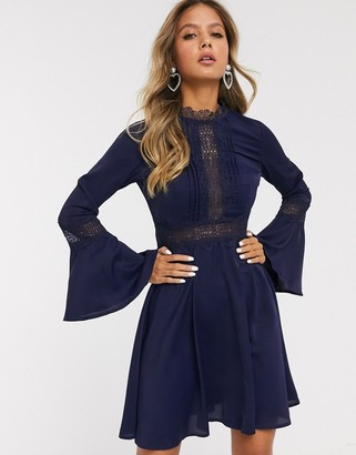 Little Mistress lace insert mini dress with flared sleeve in navy