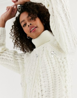 Asos DESIGN premium embellished cable jumper with roll neck