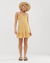 Asos Design DESIGN cami mini sundress with buttons and tiered hem in yellow stripe