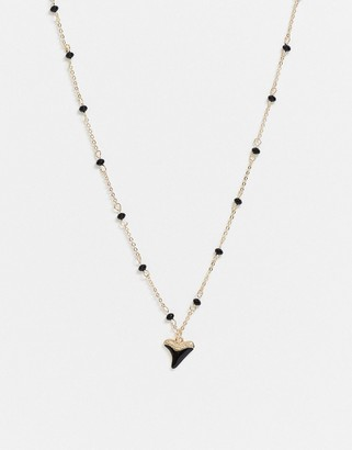 ASOS DESIGN necklace with bead chain and shark tooth pendant in gold tone