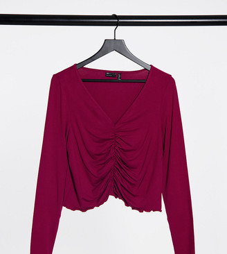 ASOS DESIGN Curve V-front ruched detail top with long sleeves and lettuce edge in burgundy