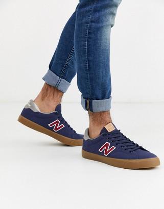New Balance 210 trainers in navy with gum sole