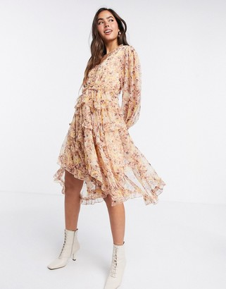 Y.A.S ruffle dress with cut out back and dipped hem in floral print